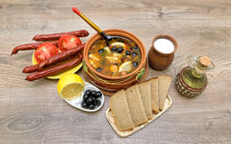 Thistle soup and other food on a wooden background Royalty Free Stock Images