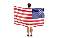 Thlete posing with american flag after victory. Athlete posing with american flag after victory on white background Royalty Free Stock Photo