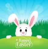 Thème heureux de Pâques avec le lapin de cachette Photos stock