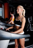 Tho athletes on treadmill Royalty Free Stock Images