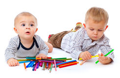 Tho brothers with pencils Stock Images