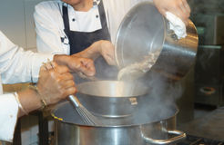 Tho chefs cooking soupe Stock Images