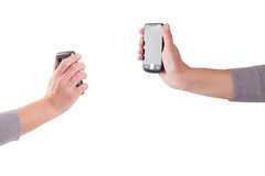 Tho hands with mobile phones Stock Photography