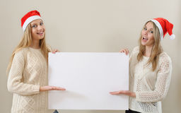 Tho happy girl in santa claus clothes hold empty blank banner Stock Photo