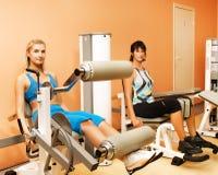 Tho women exercising Royalty Free Stock Photo