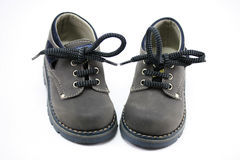 Thodler shoes. Grey toddler shoes on withe background Royalty Free Stock Image