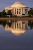 Thomas Jefferson Memorial reflected at night. Thomas Jefferson Memorial, reflected at night, seems to glow in the water of the tidal pool Royalty Free Stock Image