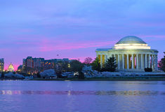 Thomas Jefferson Memorial and US Capitol at dawn during cherry blossom festival. Royalty Free Stock Image