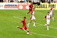 Thomas Müller from Bayern Munich. Thomas Müller  from Bayern Munich on the field kicking the ball in a friendly match Royalty Free Stock Images
