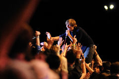 Thomas Mars, frontman of Phoenix band, singing surrounded by the audience performs at Heineken Primavera Sound 2013 Festival Stock Photography