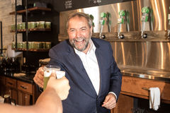 Thomas Mulcair Cheers a Beer. At a local brewing company. Thomas is the federal leader of the New Democratic Party in Canada and is running in the Canadian Royalty Free Stock Image