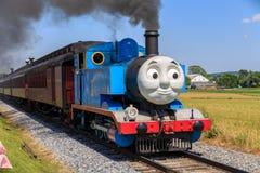 Thomas the Tank Engine near Strasburg PA. Strasburg, PA, USA – June 19, 2016: Thomas the Tank Engine chugs toward the train station in Strasburg, Lancaster Stock Photo