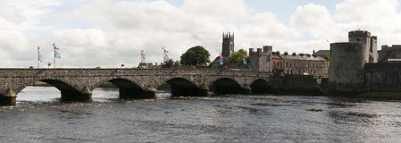 Medieval bridge and castle. In Ireland. Thomond Bridge, Shannon River, King Johns Castle, Limerick, Ireland.  Panoramic wide angle Royalty Free Stock Photos
