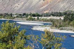 Thompson River. Anglers dot the shore of the Thompson River between Ashcroft and Spences Bridge in southern British Columbia. Deep blue water, white sandy shores Royalty Free Stock Photo
