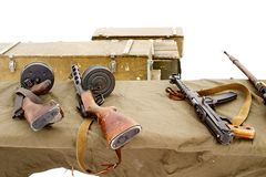 Thompson submachine gun, submachine gun Shpagin, submachine gun Sudaev at the shooting range. Boxes of ammunition. On white backgr. Thompson submachine gun stock photos