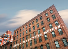 Thompson Water Meter Building in NYC. NEW YORK, USA - Apr 29, 2016: Thompson Water Meter Building. DUMBO, Brooklyn. An old water meter company building in New Royalty Free Stock Photography