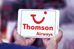 Thomson Airways logo. Logo of Thomson Airways on samsung tablet . Thomson, is the world`s largest charter airline Stock Images
