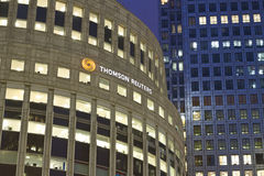 Thomson Reuters. Logo and firm on a Canary Wharf office building in London, UK Stock Image