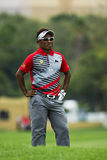 Thongchai Jaidee. Waits for his turn besides his ball, lying in the rough, on the 1st fairway Royalty Free Stock Photo