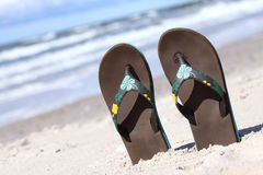 Thongs. Pair of thongs put in sand on the summer beach Royalty Free Stock Photo