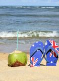 Thongs. With coconut on the beach Stock Images