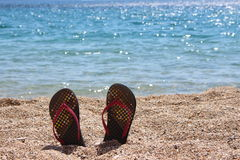 Thongs on the beach Royalty Free Stock Image