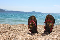 Thongs on the beach Royalty Free Stock Photo
