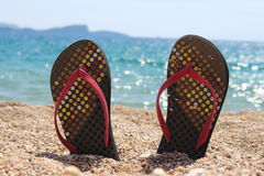 Thongs on the beach Royalty Free Stock Images
