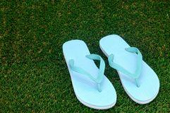 Thongs. A close up shot of thongs on artificial grass Royalty Free Stock Photography