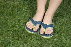 Thongs on the grass Stock Photo