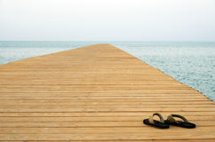 Thongs on pier Royalty Free Stock Photography