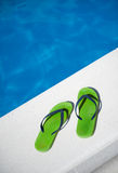 Thongs by the pool Stock Images