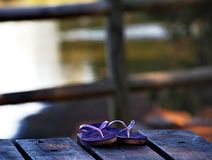 Thongs. Purple thongs on a table Royalty Free Stock Images