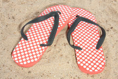 Thongs in the sand. Modern dotted thongs in the sand on the beach Royalty Free Stock Images