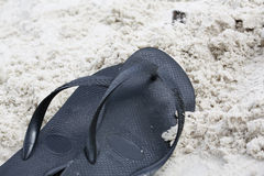Thongs On Sand. Thongs in the sand at the beach royalty free stock image
