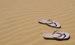 Thongs on the sand in Australia. Thongs (flip flops) on the beach in Australia Stock Photography
