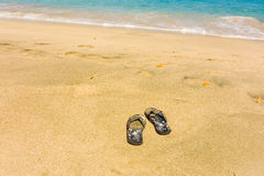 Thongs by the seashore in the windward islands Stock Images