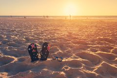 Thongs and sunglasses on beach sand Royalty Free Stock Photography