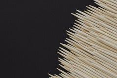 Thoothpicks на кожаной таблице Стоковое Изображение