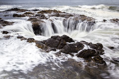 Thor's Well, Oregon Coast. Thor's Well, a feature in the Oregon coast where the water seems to drain down a lava rock sinkhole Royalty Free Stock Photos