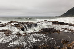 Thor's Well, Oregon. Feature known as Thor's Well in the central Oregon coast with a drama and natural wonder Royalty Free Stock Image