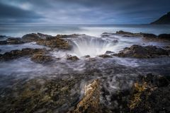 Thor`s Well. Is located in Cape Perpetua of Oregon coast and is a popular tourist site.  The legend has it that it`s the gateway to the underworld Royalty Free Stock Photos