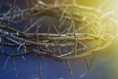 Thorn Wreath Against Blue Background In Sunlight. Symbol Of Death And Resurrection Of Jesus Christ Royalty Free Stock Image