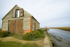 Thornham 18th century coal barn. 18th century coal barn beside the harbour on Thornham marshes, one of the most recognized landmarks on the Norfolk coast Stock Photography