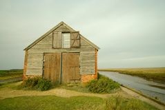 Thornham 18th century coal barn. 18th century coal barn beside the harbour on Thornham marshes, one of the most recognized landmarks on the Norfolk coast Royalty Free Stock Image