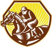 Thoroughbred Horse Racing Woodcut Retro. Illustration of thoroughbred horse racing and jockey set inside crest shield on isolated white background done in retro Royalty Free Stock Photo