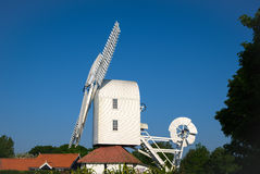 THORPENESS, SUFFOLK/UK - MAY 25 : Thorpeness Windmill Building i Royalty Free Stock Image
