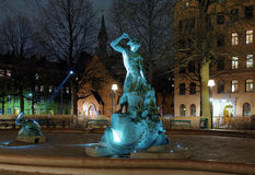Thors Fishing - fountain in Stockholm at evening stock images
