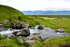 Thorsteinslundur waterfall in motion blur on overcast summer da. Y in Iceland. Typical Icelandic landscape royalty free stock photography