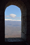 Though the window. View of the mountains and blue sky through the window Stock Photography